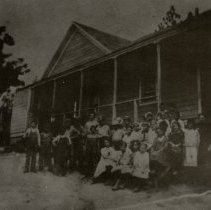 """Image of TP9649 - A 4"""" x 4"""" Black and white copy of a photo of the Soulsbyville School. The children sitting in front of the school are unidentified."""