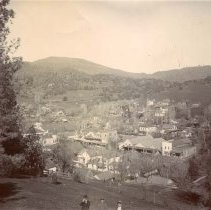 Image of P31877 - A view of Sonora from Knolls Hill looking down on Sonora.  Washington Street buildings start on Church Street and go north.  Building with long roof and three pediments is the City Livery, owned at times by John Shine and Dennis Guerin.