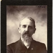 Image of TP163 - PORTRAIT- DAD BURDEN. WEARING A DOUBLE BREASTED SUIT WITH LAPEL PIN AND A BOW TIE. HE HAS CURLY HAIR AND A LONG CURLY BEARD.