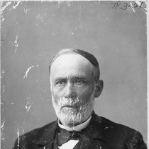 Image of TP321 - Sewell Knapp of Columbia.  An older man wearing a suit jacket, vest, dress shirt and tie.   He has a full mustache and beard.