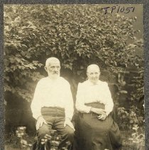 Image of TP1051 - Portrait of William Kahlmeyer and wife. Seated on chairs in a meadow. Circa 1900/1920.