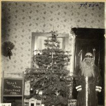 Image of TP852 - PORTRAIT- CHRISTMAS TREE AND SANTA AT REHMS SONORA - DEC. 25, 1899