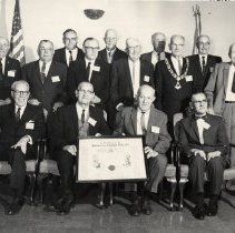 Image of TP2961 - GROUP - SONORA ELKS LODGE #1587,YEAR 1970, FRONT ROW L TO R 1. IRVING J. SYMONS, 2. JOHN MUZIO, 3. BABE MICHEL, 4. PAUL SUTER, 5. BOGIE, 6. ED. MC MAHON, 7. LOYAL KIMBALL, 8. FRED LEIGHTON, 9.CLINT SUTTLE, 10. ARMAND BAER, 11. VASSO TERZICH, 12. LYNN BRABOZON, 13. CLARENCE JOHNSON