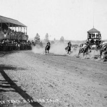 Image of TP3411 - Racetrack, Sonora, with race in progress, photograph shows four horses on near bend, track rail, grandstand and judging stand.  The track was formed mainly by horse pulling scrapers, built by Mr. Cassaretto & partner, Rocco, ca 1895.