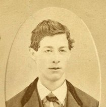 Image of TP3712 - Amel Cornelius Nelson-18 YEARS OLD. DIED JUNE 30, 1932.  The is wearing a suit jacket with large lapels and a velvet collar, a white shirt and a bow tie. His hair is parted in the center .
