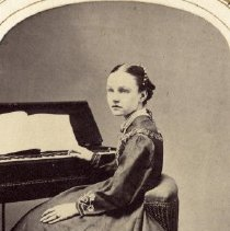 Image of TP3855 - A Black and white portrait of Gabriella Gallut sitting at a piano. Circa 1870's./ Album #11 Sewell Collection.