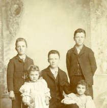 Image of TP4824 - RUNDELL FAMILY,  L-R (BACK ROW) - JOE, OTHO & ED, (FRONT ROW) ELSIE, 4 YEARS BESSIE, 8 YEARS, MARRIED WALTER BAKER. MRS. RUNDELL WAS AMELIA WEST, SISTER OF J.H. WEST.