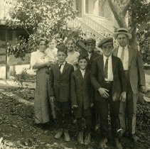 Image of TP6089 - Photo - Vigilantism and Olivier Families, Front L-R, Ernest Olivier, Louis Olivier, John Vigilantism: Rear L-R: Mrs. (Olivier) Vigilantism holding Lawrence Jr., Katie Olivier, James Olivier, Lawrence Vigilantism Sr., in front of home at N. Stewart St. next to Van Harlingen home. Lawrence was the owner of the Europa Hotel, site of the Europa Restaurant (2014) and the Rosa Italia Hotel, now the Gunn House (2014).
