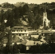 Image of TP11376 - Standard Lumber Co.- Home- D.H. Steinmetz home on Bradford Street. St. Patrick's Catholic Church right. background. Knox family home upper left corner, Spire on right is the Methodist Church.  Photo taken between 1910 and 1922.