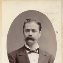 """Image of TP10344 - A 6.5"""" x 4-1/4""""  Black and white portrait of  Alfred C. Rulofson wearing suit with white shirt and ribbon tie."""