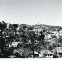 Image of TP10641 - Sonora - view Looking North after 1920..  You can see the Court House, the City Hotel and St. Patricks Church in the  background.  Many homes sill the picture.