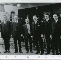 Image of TP10968 - Mother Lode Highway Association meeting in front of Sonora Theater,Nov. 16, 1922. Left to right:P.B.Goss, Ralph McGee, J.B.Curtin, H.E. Dillinger, W.J. Loring, Harold Tollon. A.D. Stevenot, C.H. Segerstrom. Better highway for the Mother Lode was reason for this group in Sonora in early 1920's.