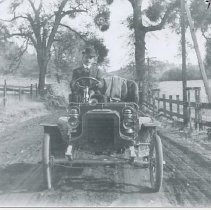 Image of TP4860 - Charles Goelz (pioneer auto dealer) in his first car, a 1-Cycle Reo. Picture taken on the old road between Sonora and Jamestown, about  1906 or 1907.