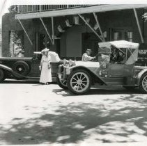 Image of TP12582 - HORSELESS CARRIAGE CLUB MEMBERS OF SAN FRANCISCO VIEWED THE FALLON HOUSE IN COLUMBIA STATE PARK ON A WEEKEND TOUR.   MRS.BARNEY BECKER OF WALNUT CREEK STANDS BESIDE THE BECKER'S 1923 DOBLE STEAMER, WHILE HER HUSBAND CHATS WITH MR. AND MRS. EDWARD L. ANDERSEN OF BURLINGAME, WHO TRAVELED IN A 1913 PIERCE ARROW RUNABOUT.