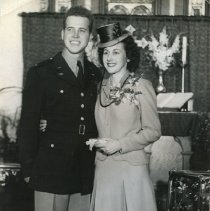 Image of TP15524 - A black and whit portrait of Ray Dambacher and Geraldine Harvey, bride and groom. Groom WWll Army Personnel.