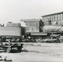 """Image of P37090 - A 4-1/2"""" x 7-1/2"""" Black and white photo of Sierra Railroad engine #22 at Jamestown roundhouse, where repairs and etc. are done."""