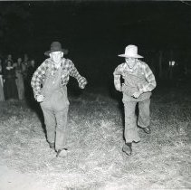 Image of TP2118 - Group- Stage setting, 2 men racing in period dress. Tuolumne County Gold Centennial Celebration. 1948-50