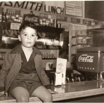 Image of Robert V. Smith on the counter at Raysmith Drugs, Mission Beach, 1950