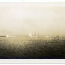 Image of Sailboats and ships in an unidentified location.