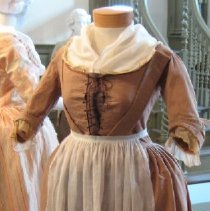 Image of Brown gown with robings and pleated cuffs.