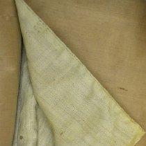 Image of Detail of homespun lining at bottom of hem.