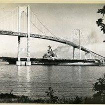 Image of USS Intrepid (CV-11) travelling under the Newport Bridge.