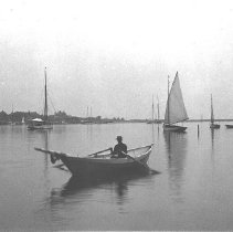 Image of PHOTOGRAPH, MARBLEHEAD HARBOR WITH MAN ROWING DORY