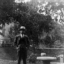 Image of PHOTOGRAPH, BENJAMIN J. LINDSEY, JEREMIAH LEE MANSION GARDEN, 161 �WASHINGTON ST. - GRAY-TONED ALBUMEN PRINT, MOUNTED ON A BORDERED GREY STUDIO CARD; IMAGE OF BENJAMIN J. LINDSEY STANDING IN THE JEREMIAH LEE �MANSION GARDEN, JUST ABOVE THE SUNKEN GARDEN.
