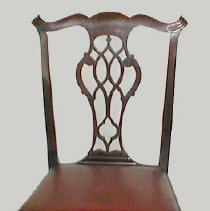 "Image of CHAIR, (SIDE) - AMERICAN MAHOGANY SIDE CHAIR HAVING A FLARING BACK WITH �SERPENTINE CREST RAIL WITH FLUTED TERMINALS & CURVING TO A �PIERCED SEAT RAIL WITH GOTHIC FEATURES INTERLACED SPLAT WHICH �ALSO HAS GOTHIC FEATURES, A MOLDED SEAT RAIL & AN APRON WITH �GADROONING CONTINUING TO CABRIOLE LEGS ENDING IN BALL & CLAW FEET� (FRONT); REAR LEGS ENDING IN SQUARED PAD FEET.  THE FLARING SLIP� SEAT IN RED SIMULATED LEATHER.  BRASS PLAQUE ATTACHED TO BACK �READS: ""CHAIR USED BY JEREMIAH LEE IN HIS HOUSE.  PRESENTED TO �THE LEE MANSION 1933 IN MEMORY OF HIS GREAT-GREAT-GREAT �GRANDDAUGHTER, HELEN AMORY ERNST."""