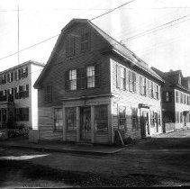 Image of PHOTOGRAPH, BROWN HOUSE, (BUNCH OF GRAPES TAVERN), 2 PICKETT ST.,�  (COR. WASHINGTON ST.) - BLACK & WHITE PHOTOGRAPH WAS TAKEN FROM THE STREET.  THE PHOTO �IS LABELED ON THE PAGE AS BEING THE BROWN HOUSE.  THE HOUSE ABUTS� THE STREET & HAS A GAMBREL/SALTBOX ROOF.  THE HOUSE HAS AN �ENTRANCE ON PICKET & WASHINGTON STREETS.  IT IS A TWO STORY �HOUSE.