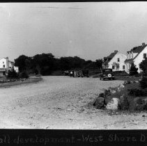 Image of PHOTOGRAPH, THE HALL DEVELOPMENT, WEST SHORE DRIVE - BLACK & WHITE PHOTOGRAPH SHOWING A ROAD IN THE MIDDLE OF THE �IMAGE, TWO HOUSES ARE ON THE RIGHT & ONE HOUSE CAN BE SEEN ON �THE LEFT.