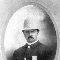 Image of PHOTOGRAPH, POLICE OFFICER ROBERT HARRIS - SEPIA-TONED OVAL MATTE PRINT MOUNTED ON STUDIO CARD; IMAGE OF �POLICE OFFICER ROBERT HARRIS.
