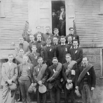 Image of PHOTOGRAPH, GROUP OF MEN POSING ON THE STEPS OF THE OLD TOWN HOUSE