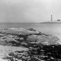Image of PHOTOGRAPH, MARBLEHEAD NECK LIGHT HOUSE FROM ICY SHORE - GRAY-TONED MATTE COLLODIAN PRINT WITH NARROW WHITE BORDER; IMAGE �OF MARBLEHEAD NECK LIGHT HOUSE FROM ICY SHORE.