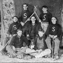 "Image of PHOTOGRAPH, ""SWEET MEATS"" ROLLER SKATING HOCKEY TEAM - BROWN-TONED, GLOSSY, PRINTING-OUT PAPER PRINT, MOUNTED ON LARGER ,�