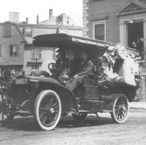 Image of PHOTOGRAPH, PAINE'S BOSTON EXPRESS MODEL T CAR/VAN LOADED WITH GOODS, IN FRONT OF THE TOWN HOUSE - GRAY-TONED MATTE COLLODIAN (?) PRINT, UNBORDERED, MOUNTED ON �HEAVY, DARK-COLORED CARDBOARD; IMAGE OF PAINE'S BOSTON EXPRESS �MODEL T CAR/VAN LOADED WITH GOODS IN FRONT OF THE TOWN HOUSE.