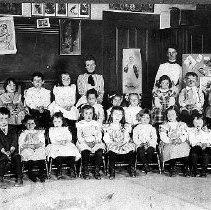 Image of PHOTOGRAPH, KINDERGARTEN CLASS - GREY-TONED GLOSSY PRINT, MOUNTED ON GREY CARDBOARD STUDIO CARD; � IMAGE OF A 1901 KINDERGARTEN CLASS.