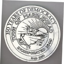 "Image of PAPERWEIGHT, 350TH ANNIVERSARY OF INCORPORATION (1649-1999) - CIRCULAR, WHITE MARBLE PAPERWEIGHT WITH DESIGN OF MARBLEHEAD'S �TOWN SEAL & ""350 YEARS OF DEMOCRACY 1649-1999"" INCISED ON FACE �OF OBJECT IN BLACK INK. IS IN A CARDBOARD BOX WITH INFORMATIONAL �SHEET ON PRODUCT."