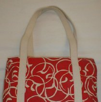 Image of BAG, 'MARBLEHEAD HANDPRINTS' - LARGE, ZIPPERED CANVAS BAG IN RED RESIST SWIRL DESIGN.  TAG OF �MAKER IS SEWN ON SEAM INSIDE. OPEN POCKET ON OUTSIDE & INSIDE. � 2 STRAP HANDLES THAT ARE SEWN AROUND BODY OF BAG.