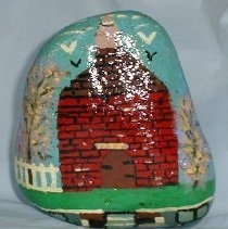 Image of ROCK, IMAGE OF POWDER HOUSE (BETWEEN 31 & 37 GREEN ST.) - ROCK WITH HAND PAINTED IMAGE OF THE POWDER HOUSE PAINTED IN �PRIMARY COLORS.  IMAGE IS OF A BRICK, CONE SHAPED BUILDING WITH �PICKET FENCE ON 1 SIDE, FLOWERING SHRUBS ON BOTH SIDES & BIRDS FLYING ABOVE.