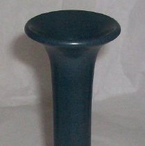 Image of CANDLESTICK, MARBLEHEAD POTTERY - CYLINDRICAL, EARTHENWARE CANDLESTICK WITH DARK BLUE, LOW LUSTRE GLAZE. SHALLOW  FOOT, STRAIGHT-SIDED SHAFT & FLARED RIM.   Made by Marblehead Pottery.