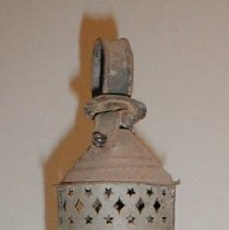 "Image of LANTERN, CARRIED BY JOHN HARRIS, CONDUCTOR ON THE EASTERN RAILROAD, WHICH RAN FROM MARBLEHEAD TO SALEM & THEN CONNECTED TO BOSTON. ACCIDENT ON NOV. 3, 1848 - EARLY RAILROAD LANTERN WITH, JUDGING BY ITS WEIGHT, A CRYSTAL CHIMNEY. THE VENTILATOR AT THE TOP IS PIERCED WITH TWO ROWS OF STARS FLANKING A ROW OF DIAMONDS. A LINE OF STARS IS ALSO CUT INTO THE LAMP'S METAL BASE. IT CONTAINS AN OIL FONT WITH TWO WICKS & HAS A 1 7/8"" RING ON THE TOP."