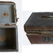 Image of SMALL TRUNK FOR PAPERS, FORMERLY - SMALL TRUNK (BOX) FOR PAPERS; WOOD FRAME WITH LEATHER COVER, LEATHER HANDLE ON LID, LEATHER STRIPS & BRASS NAILHEAD TRIM; METAL LATCH & KEYHOLE ON FRONT (KEY MISSING); BROKEN INTERNAL LEATHER STRAP BETWEEN BOX & TOP; LINED WITH BLUE PAPER.