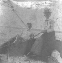 Image of PHOTOGRAPH, TWO PEOPLE IN A SAILBOAT - SEPIA-TONED ALBUMEN PRINT; IMAGE OF TWO PEOPLE IN A SAILBOAT, �FROM AN ALBUM.