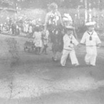 Image of PHOTOGRAPH, CHILDREN IN A (HORRIBLES?) PARADE - SEPIA-TONED ALBUMEN PRINT; IMAGE OF CHILDREN IN A (HORRIBLES?) �PARADE, FROM AN ALBUM.
