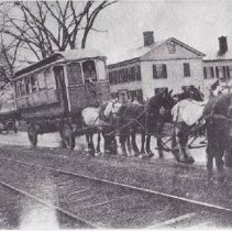 Image of Trolley car being moved by horses