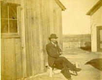 Image of George Rappleye on a bench