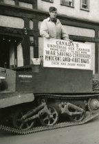 Image of BREN GUN CARRIER IN PENTICTON DURING WAR SAVING CERTIFICATES TOUR WITH SIGN