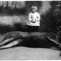 Image of Dorothy Hiscock with a dead mule deer