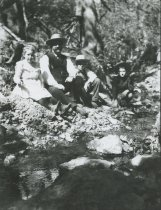Image of Frederick Rindge and children at creekside